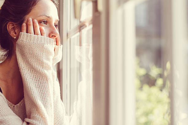 Thoughtful woman at home - copyspace